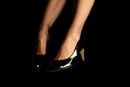 female legs in high heel shoes isolated